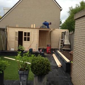 bestrating en tuinhuis breda